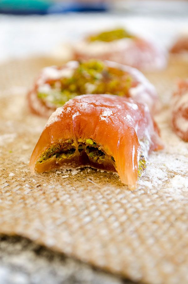 Homemade Turkish Delight stuffed with ground pistachio. You should make your own turkish Delight at home if you can't find it in your area! You need just a few basic ingredients and cream of tartar. Surprise your guests with the Turkish Delight made by yourself! | giverecipe.com | #turkish #turkishdelight #sweet #dessert #cornstarch #tartar