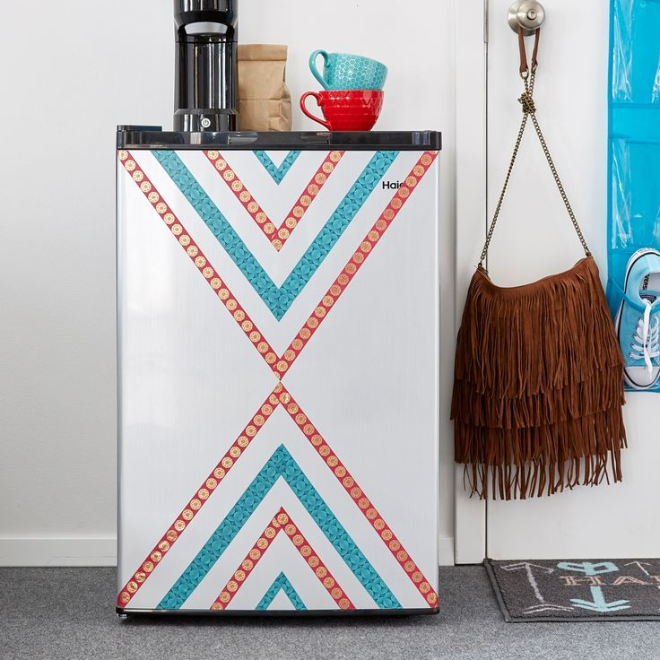 The dorm mini fridge is a college essential, but it doesn't have to be boring. Try DIY décor using tape to create fun designs on the front door. This DIY duct tape idea is one you can have fun with and change through out the year.
