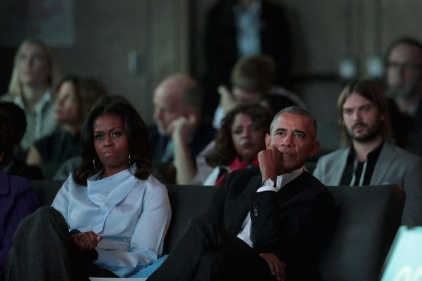 Michelle Obama Photos - Former first Lady Michelle and former president Barack Obama listen to speakers at the inaugural Obama Foundation Summit on October 31, 2017 in Chicago, Illinois. The two-day event will feature a mix of community leaders politicians and artists exploring creative solutions to common problems, and experiencing art, technology, and music from around the world. - Michelle Obama Photos - 18 of 9420