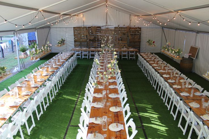 Farmyard wedding - Pavilion, Artificial grass, original timber trestles, Americana chairs, festoon lights. #rustic wedding #pavilion #farmyard wedding #Americana # timber trestles