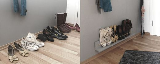 Shoe rack. Made of two pieces of wood and a yellow rubber band. Painted  same colour as wall.