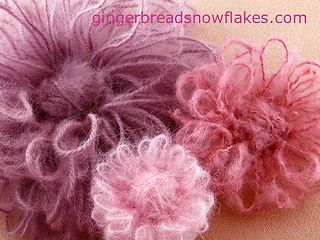 Fluffy yarn flowers made using flower looms by gingerbread_snowflakes, via Flickr