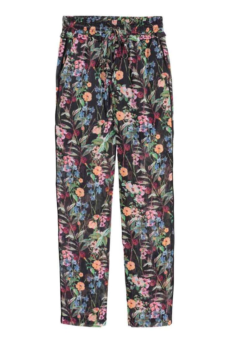 40 Patterned chiffon trousers: Trousers in patterned crinkled chiffon containing glittery threads, with a regular waist with wide, frill-trimmed elastication and a drawstring, side pockets and slim, straight legs.