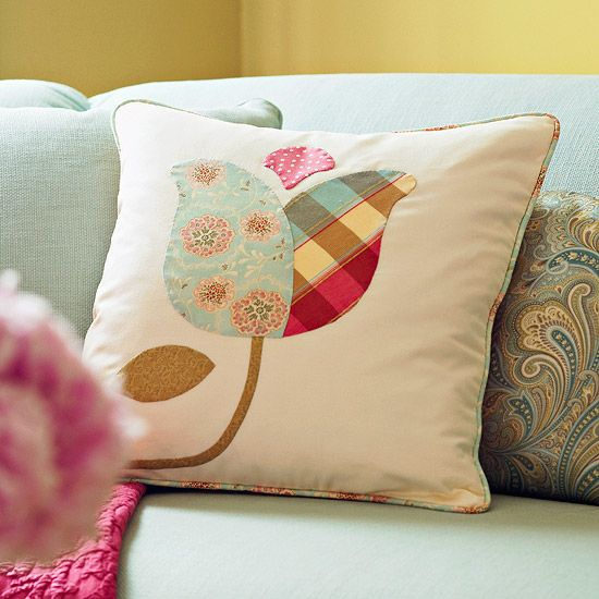 Applique tulip pillow propped up against paisley pillow on a mint green couch http://www.bhg.com/crafts/sewing/accessories/easy-sewing-projects/#page=30