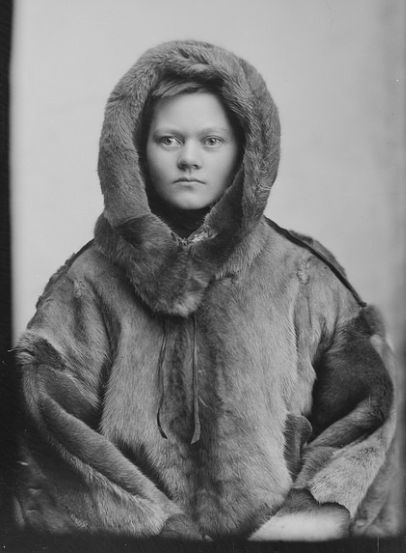 In 1903, Norwegians Fritjof Nansen and Roald Amundsen were heroes. Roald Amundsen, led the first expedition to traverse the Northwest Passage in 1903–06. Marie Hoeg is posing as they were, in fur pretending to be an Arctic explorer.