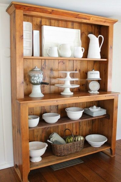 Beautiful hutch displays white bowls, platters and cake stands eclecticallyvintage.com
