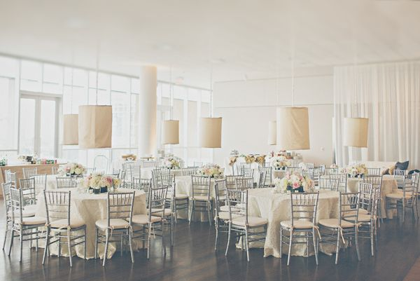 Round reception tables with fabric lanterns and gray bamboo chairs | photography by http://www.lovetheschultzes.com