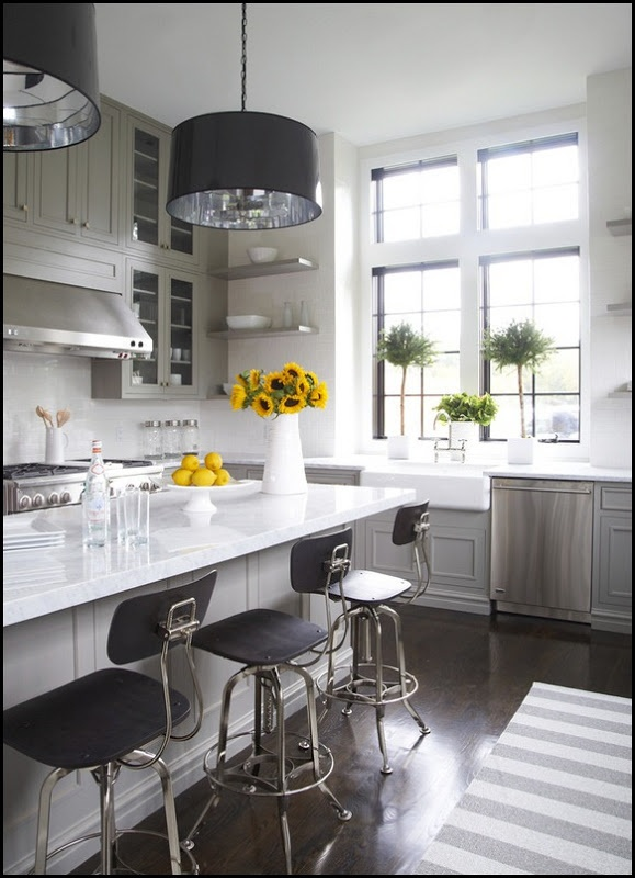 LOVE these cabinets that go all the way to the ceiling, plus the large windows and the apron front sink. Whites with grays. So pretty