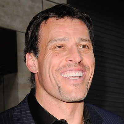 """The author of several best-selling self-help books, including Awaken the Giant Within, Tony Robbins has become well known for his much-publicized """"firewalk"""" seminars."""