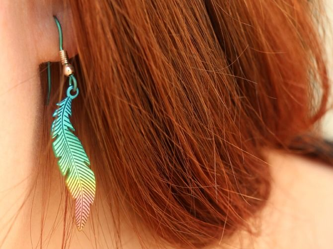 Colourful feather earrings worn by@twinklinpixi3 , they look great with your hair colour! #titanium #feather #earrings anodised pink, green through to blue