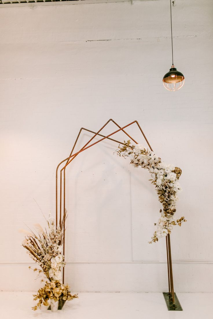 Real Wedding: Karis + Blake :: Sweet + Stylish Wedding with Dried Florals | Copper Geometric Arch with dried flowers Arch | Modern Wedding Ceremony Decor | #realbride #realwedding #aandbabe #influencerwedding #ruedeseine
