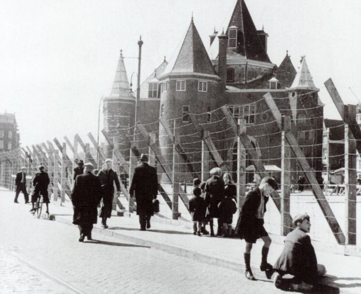 the Jewish ghetto in Amsterdam, 1940s This is an example of the Jewish Ghettos used during World War II. The wire fence shown separated them from the rest of society.