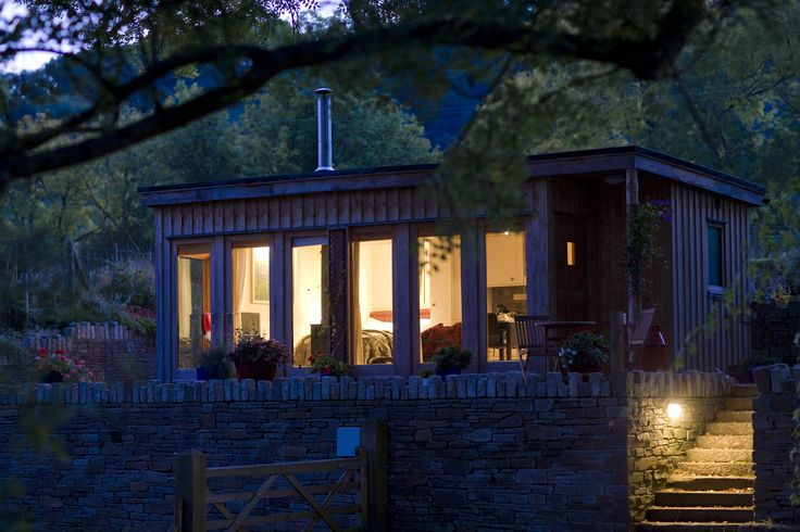Snug, off grid cabin with woodburning stove tucked into green fields by the River Wye - The perfect romantic bolthole.