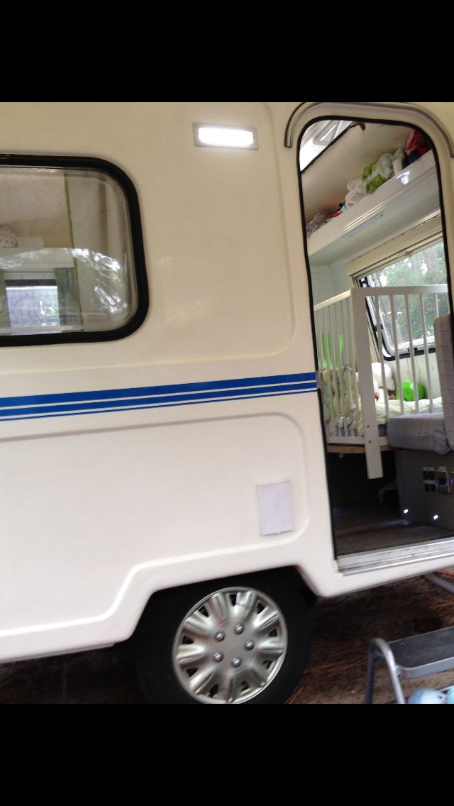 """New LED awning light fitted. It's a 240v flush fit exterior """"brick light"""" which gives a flush fitting rather than your typical 12v surface mounted caravan type."""