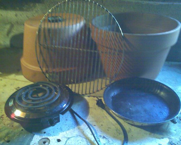 """Cheap redneck ceramic smoker:  Hardware - 2 large terra cotta, or earthenware non-lead non-glazed planters, electric hot plate that will fit, standard grill grate that fits inside, and a replacement grill thermometer whose probe fits inside the planter hole while the dial can rest on top, a """"garbage"""" pan without a handle or heavy duty pie pan,  wood chips. i bought the planters at the same hardware store as the grate, hot plate and thermometer to make sure they fit together."""