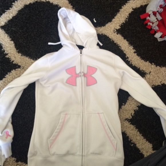 Under armer zip up hoodie All white with a pink under armer sign, 2 years old. Still in good condition Under Armour Jackets & Coats
