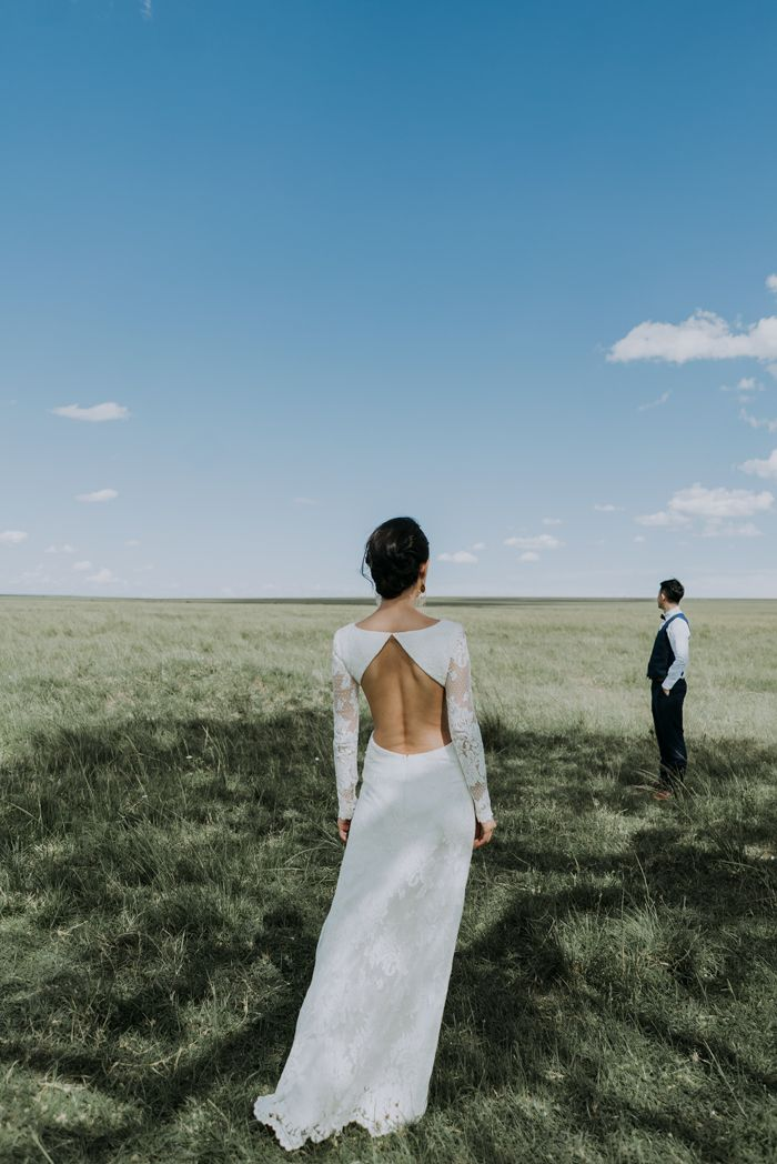 Gorgeous open back gown with lace sleeves | Image by Tu Nguyen Wedding