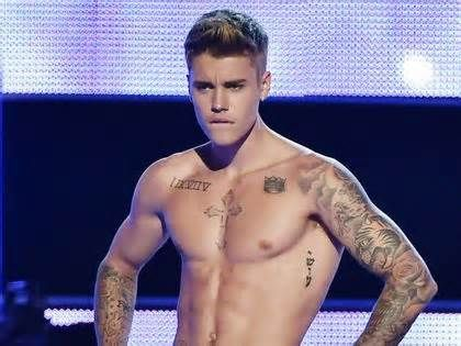 """Justin Bieber adds massive torso tattoo to ink collection While most Beliebers gave their two cents worth on the tattoo, others took time to comment on the photo itself. """"Dude, clean your bathroom,"""" one fan chimed. """"I didn't notice that (tattoo). I was too busy looking at the shake packets. LOL,"""" another ..."""