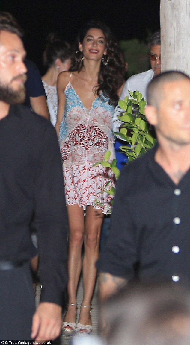 Leggy look: Amal set off her summery minidress with a pair of strappy silver wedges ...
