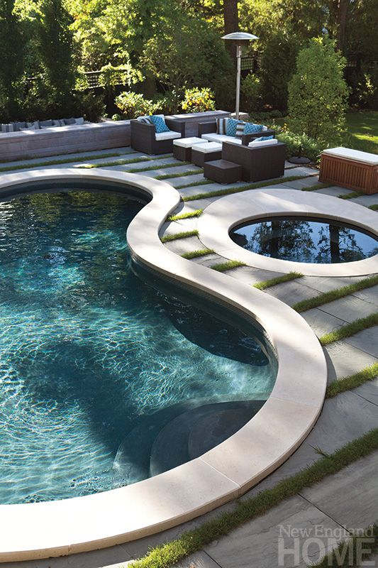 Suburban Boston home with a casual West Coast back yard. Landscape architect Gregory Lombardi accentuated the curves of the existing pool by pairing it with horizontal bands of bluestone and grass.