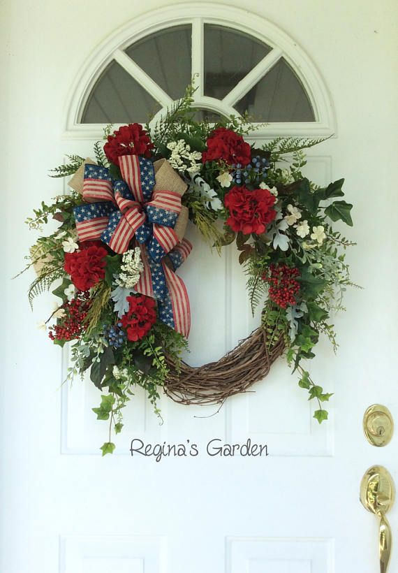 Patriotic Wreath-Americana Wreath-Summer Door Wreath-Memorial Day Wreath-Fourth of July Wreath-Farmhouse Decor-Country Wreath-Rustic Wreath Show your patriotic spirit with this old-fashioned red, white and blue garden wreath. I love the look of this wreath....it makes me think of sitting on the front porch on a warm summer day. It features a gorgeous mix of summer garden ferns, ivy and other foliages mixed with clusters of red and blue berries, white meadow flowers and lush red geraniums. A…