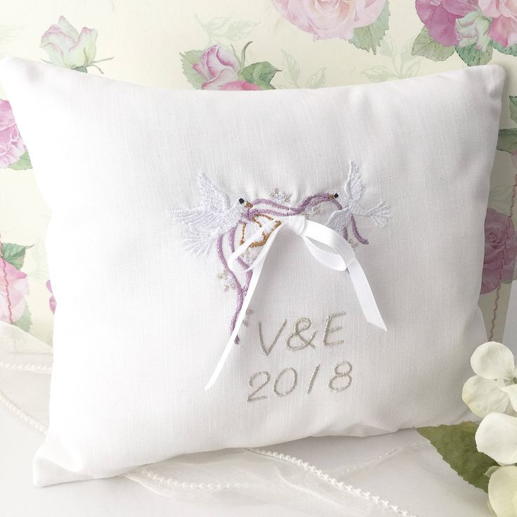 A personal favorite from my Etsy shop https://www.etsy.com/listing/595483931/personalized-ring-bearer-pillow-custom