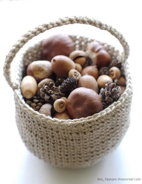 Small linen crochet basket.  Reminds me of Nantucket lighthouse baskets!
