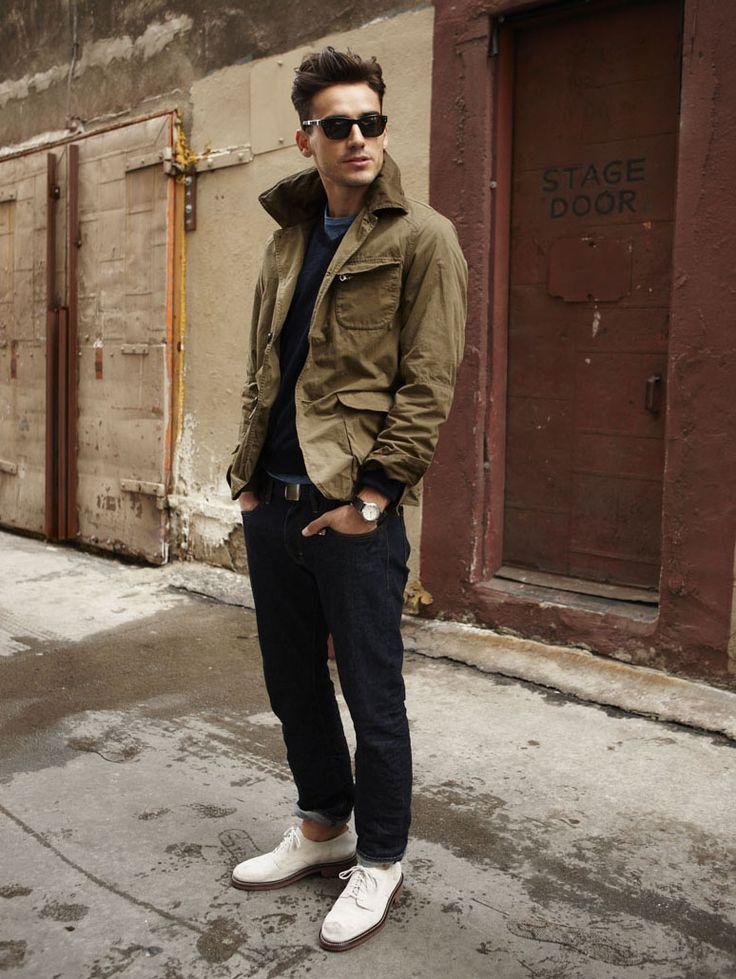 Shop this look on Lookastic:  https://lookastic.com/men/looks/barn-jacket-v-neck-sweater-crew-neck-t-shirt-jeans-derby-shoes-belt/358  — Navy V-neck Sweater  — Tan Barn Jacket  — Black Leather Belt  — Navy Jeans  — White Leather Derby Shoes  — Blue Crew-neck T-shirt