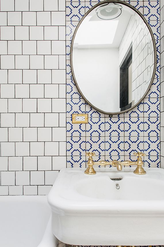 The room bathroom with pretty tiles combo