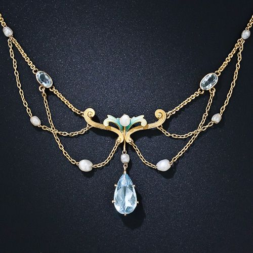 Art Nouveau necklace of 14 K yellow gold, with 2 oval cut aquamarines, seven oval-rice freshwater pearls, and a pear cut aquamarine pendant of 3 carats.