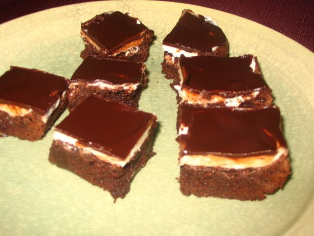 These brownies come from Cooks Illustrated. Best. Brownies. Ever. They take some time to make due to cooling after baking and applying the frosting but its well-worth it. They can be made, of course, without the glaze and/or frosting and are still excellent.