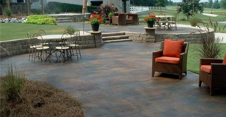 Concrete Patios - this site was helpful and mentioned water based stains instead of acid based
