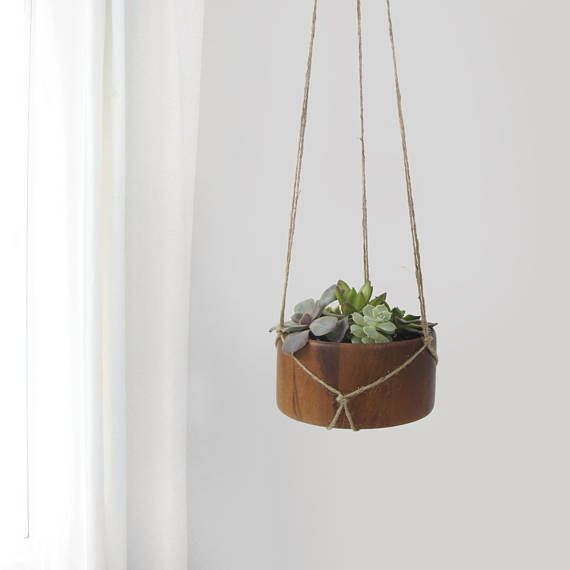Minimalist dark wood hanging planter for scandinavian decor