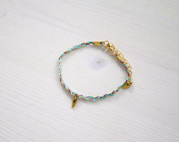 New to MoonTideJewellery on Etsy: Friendship Bracelet in Gold Pink & Blue with Arrow Charm - Bohemian Bracelet - Gypsy Bracelet - Festival Bracelet - Arrow Bracelet (11.99 GBP)