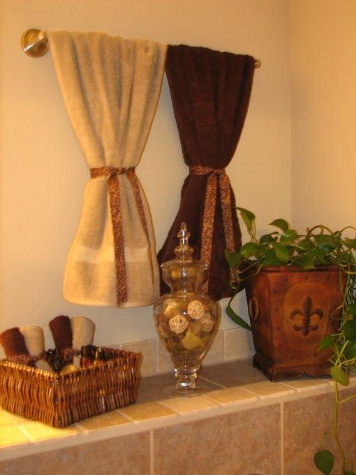 Best 25 bathroom towel display ideas on pinterest for Brown beige bathroom ideas