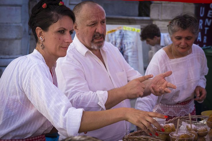Market traders talking with customers, Dubrovnik.