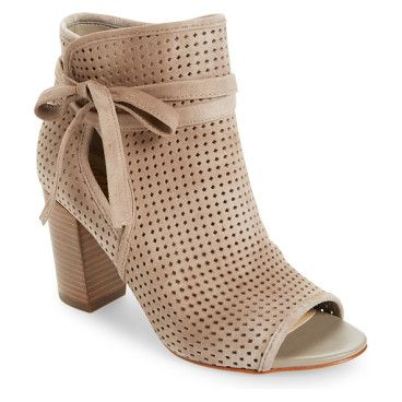 ellery open toe bootie by Sam Edelman. A perforated upper and open toe add breezy updates to a sleek leather bootie lifted by a chunky stacked heel.