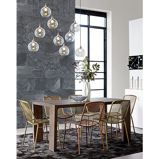"""fly by nine. Industrial modern chandelier by Mark Daniel suspends nine glass globes from nickel-finished iron canopy. Pendants stagger in length on black cords 19"""" to 52"""". Great look with filament bulbs or our 25W candelabra bulb. Hanging hardware included. Learn about Mark Daniel on our blog."""