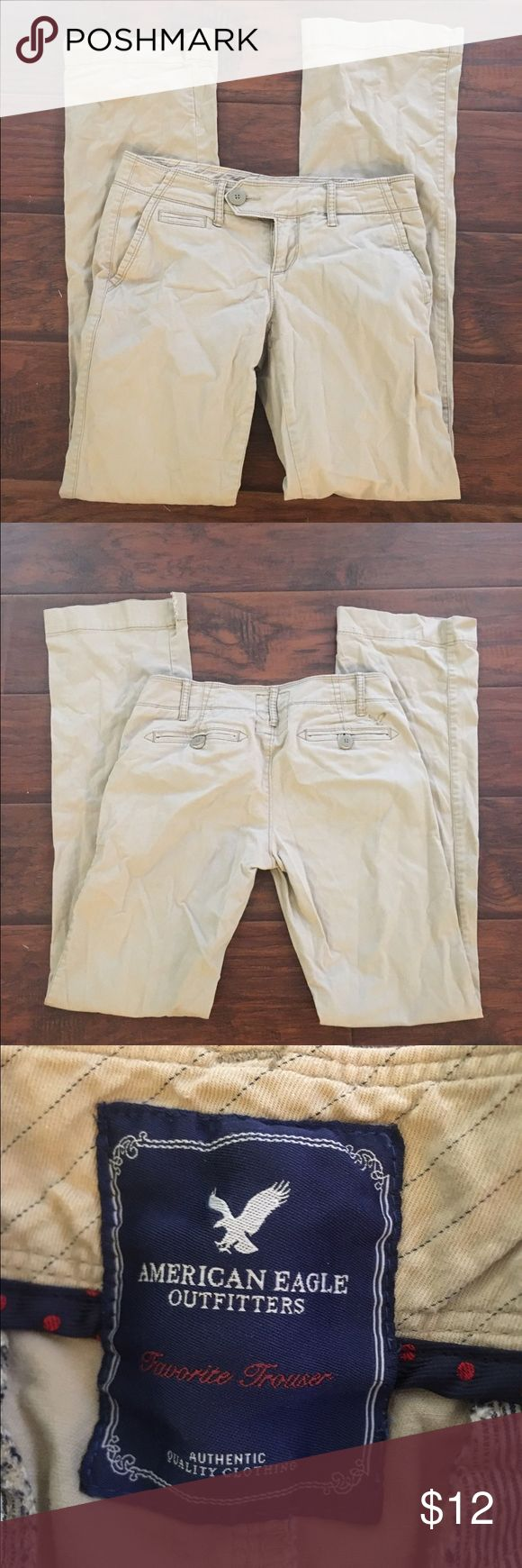 """American Eagle khaki trouser pants In excellent condition except for small slots at each ankle so they will fit over your boots. Priced accordingly. These are perfect otherwise! They are the """"favorite trouser."""" 98% cotton. Thanks for looking.💕 American Eagle Outfitters Pants Trousers"""