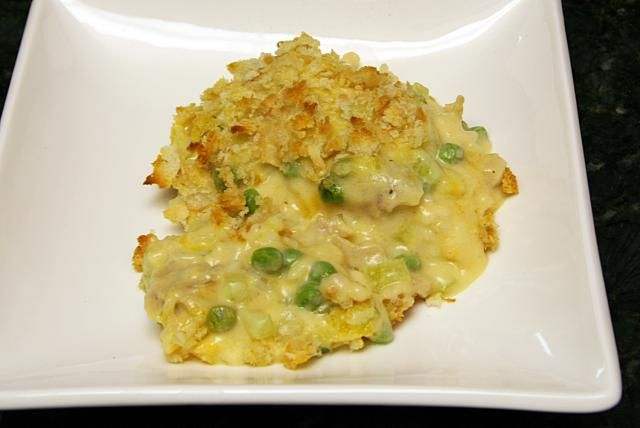 This delicious tuna casserole contains packaged or canned tuna, chopped onion and other vegetables, peas, rice, and a homemade cheese sauce.