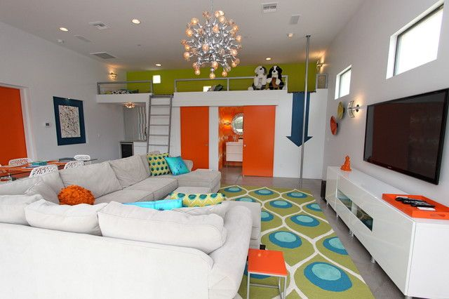 contemporary family room by Chimera Interior Design, loft over bathroom & closet is 5 ft wide by 24 ft long, with fire pole. Teal, green and orange.