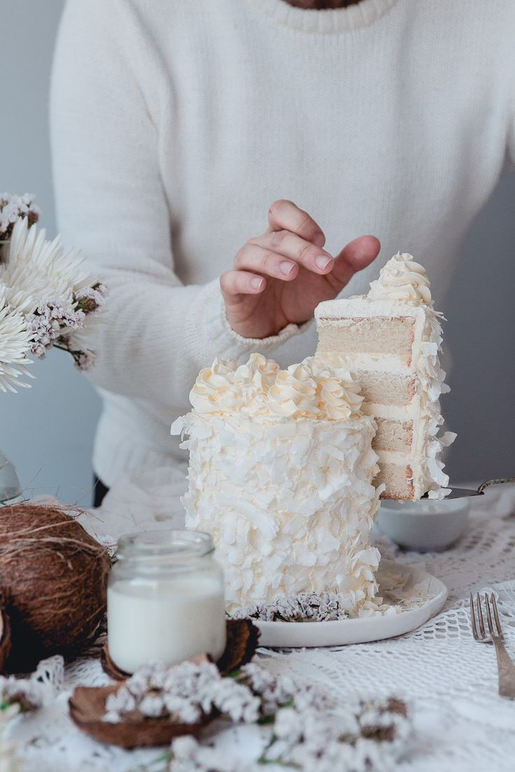 White Coconut cake with silky coconut buttercream and isomalt sail