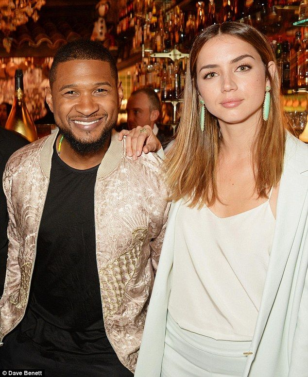 Midas touch!Usher looked incredible in a golden jacket as he posed with his co-star Ana de Armas while attending a bash for Robert De Niro in Cannes on Sunday