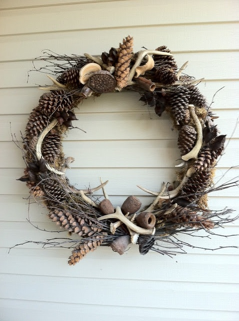 A rustic antler wreath.  A creative touch with an all natural feel.