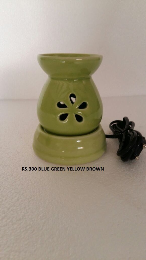 Electric Air freshner with aroma oil Combo. Directions to use: Pour 1-2 teaspoons of any of the three oils on the top bowl surface of ceramic burner and switch on the electric current. After few minutes oil becomes heated and starts diffusing. Safety Information: Keep away from children as it becomes heated.