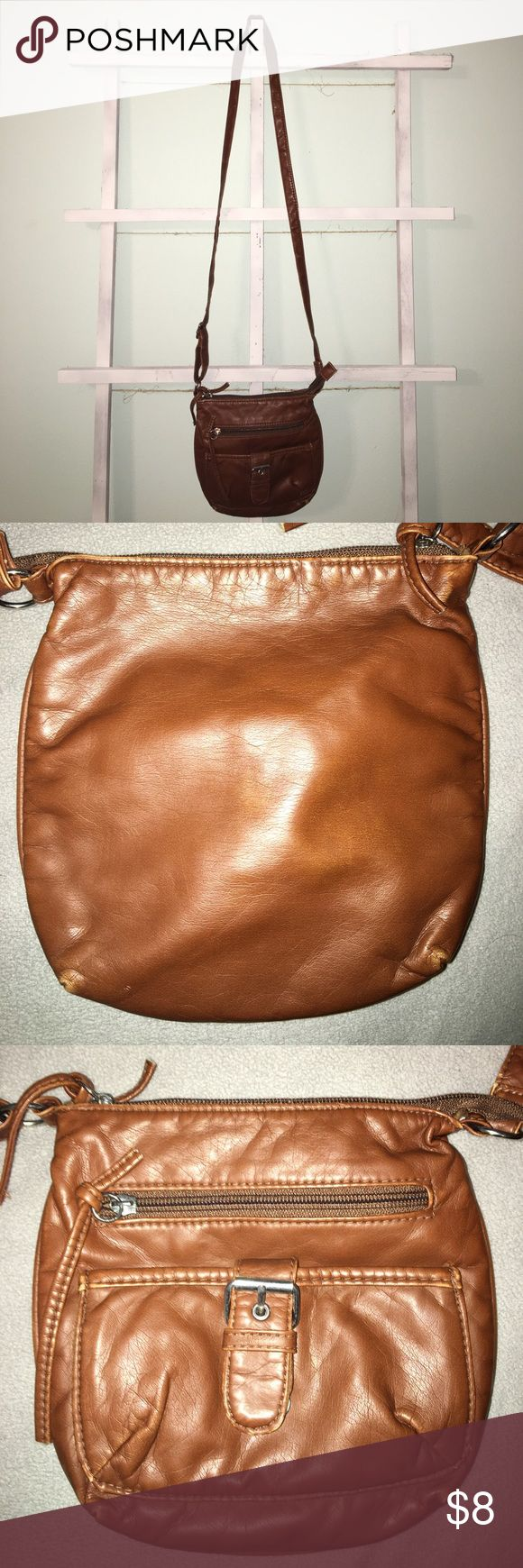 Cross body purse Brown, faux leather cross body purse from Claire's! Nice for festivals and short shopping trips!! Has 2 pockets in the front, one with a zipper and one with a buttoned buckle. There's one big pocket and 2 mini pockets in the inside! Claire's Bags Crossbody Bags