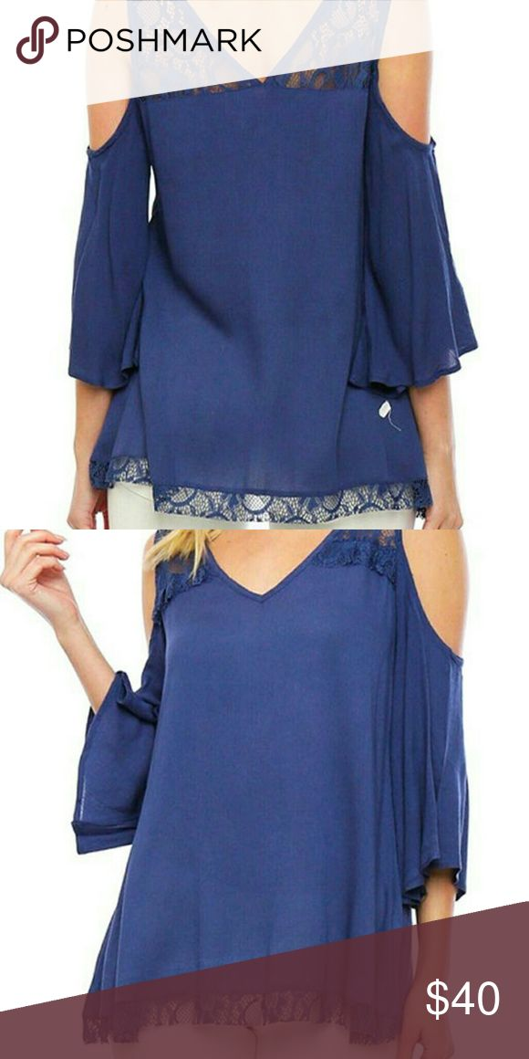 Lace inset cutout top Trending new woven crepe top with cold shoulders and lace insets on the shoulders and an asymmetrical hemline. Beautiful top, a must have. Tops Blouses