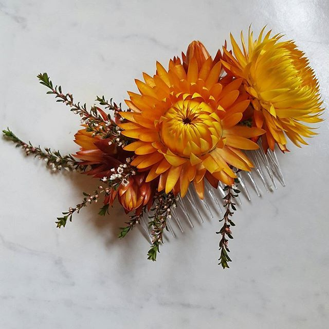 Yellow paper daisy floral hair comb.
