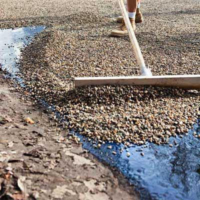 Here's how, using a chip seal paving technique, you can get that classic gravel driveway look without the annual raking and replenishment usually required. | Photo: Keller + Keller | thisoldhouse.com