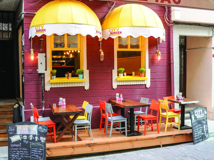 Wooden table, colorful chairs. Restaurant Design.